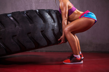 Sexy And Fit Girl With Tire