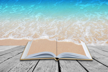 Open book with Sea Beach background