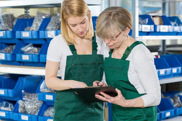 Women working in storehouse