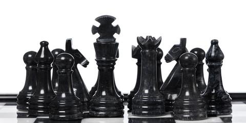 Black chessmen on chessboard