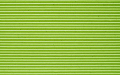 green corrugated paper background.