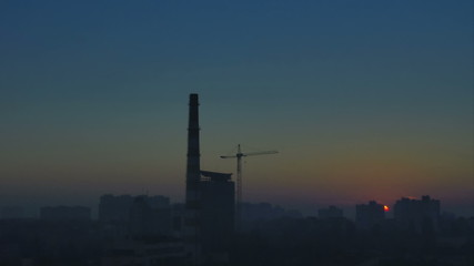 The industrial foggy city landscape. Fast time lapse