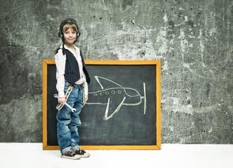 Boy near blackboard