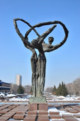 Sculpture featuring three dancing persons, in Astana,