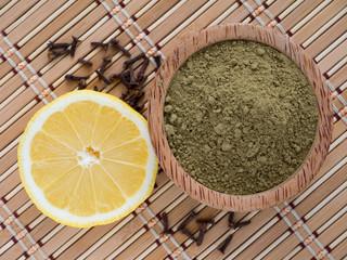 Henna powder and lemon on the bamboo mat