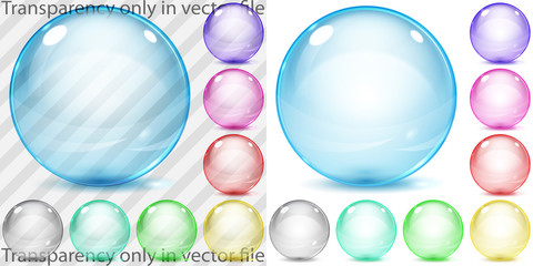 Set of multicolored transparent and opaque glass spheres