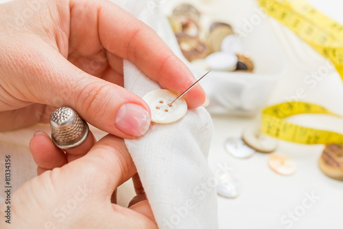 Poster Sewing button on cloth