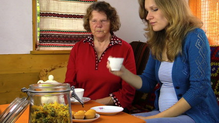 tea time cupcake in village room, woman give grandmother sugar