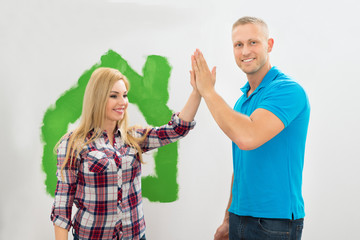 Couple Giving High Five To Each Other
