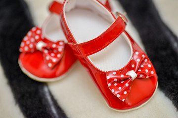 Red shoes baby girl with bow