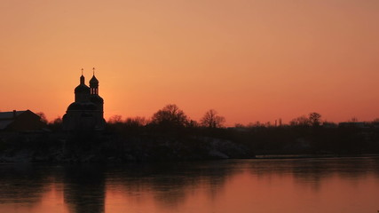 Sunset against orthodox church. Time lapse