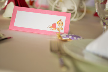 Table card with shaped baby girl on it