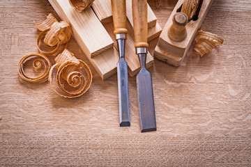 chisels shavings planks woodworkers plane on wooden board