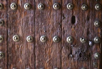 Wooden door with iron ornaments