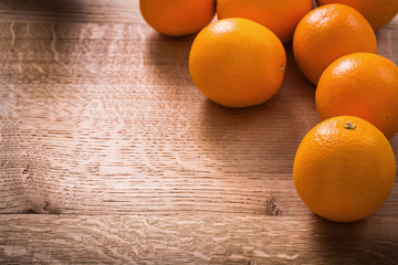 oranges on vintage wooden board with organized copyspace