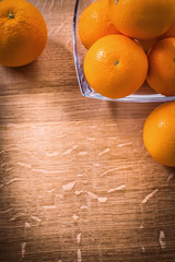 organized copyspace orange fruits in glass square bowl on wooden
