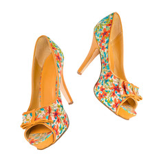 women's shoes in floral print in the air on a white background