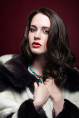 Young beautiful woman in fur coat and with green pistachio colou
