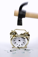Breaking an alarm clock with a hammer