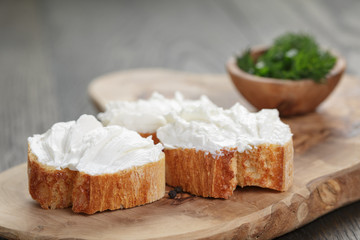 homemade appetizing crostini with soft cheese cream herbs