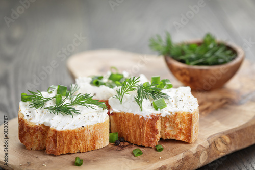 Fotobehang Voorgerecht homemade appetizing crostini with soft cheese cream herbs