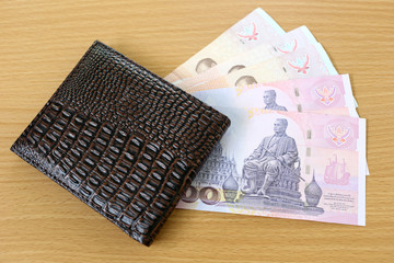 Banknotes of Thailand in wallet.