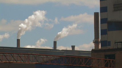 Smoking chimneys on the roof of the plant.