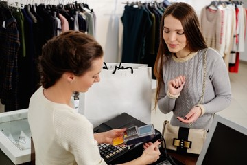 Woman buying in fashion showroom