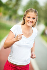 Happy young woman jogging