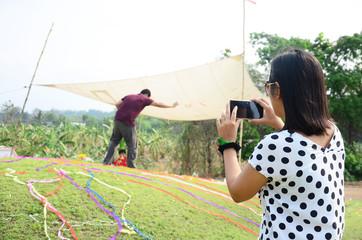 Thai women use mobile phone take photo Ceremony