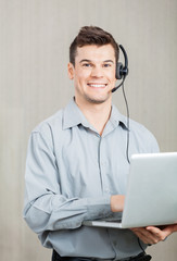 Male Call Center Employee With Laptop