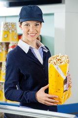 Beautiful Worker Holding Popcorn At Cinema Concession Counter