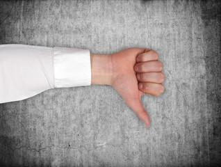 hand showing dislike sign
