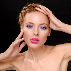 Beautiful girl with bright make-up keeps head in his hands.