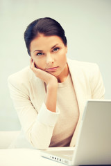 pensive woman with laptop computer