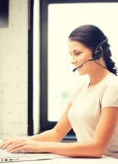 helpline operator with laptop computer