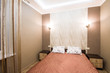Hotel room. Small bedroom with double bed. - 81349315