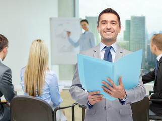 happy businessman with open folder