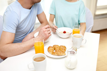 close up of couple having breakfast at home