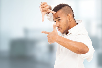 african man is focusing with his hands