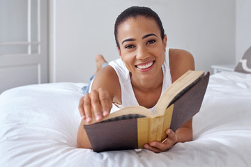 woman book laying bed