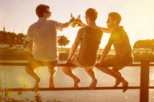 Three friends drinking beer - 81351176