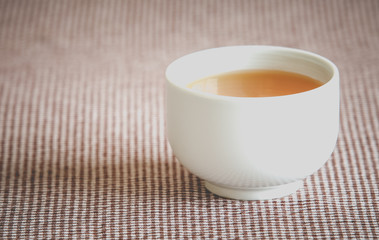 A cup of hot chinese tea on table