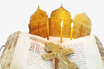 Orthodox Christian still life with open ancient Bible and cross