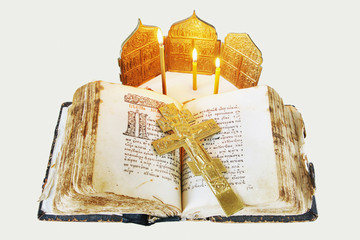 Orthodox Christian still life with open ancient book and cross