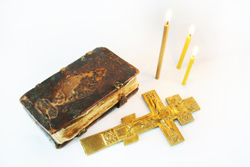 Christian still life with metal crucifixion and ancient book