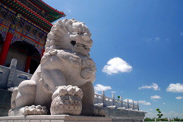 Stone male Lion and ball at Chinese Temple