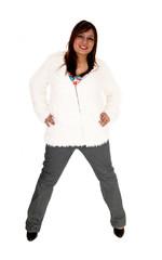 Woman standing in jacket.