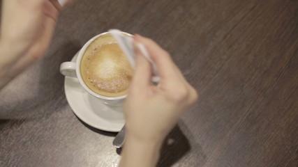 Add the sugar in cappuccino