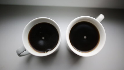 instant coffee in two cups of white